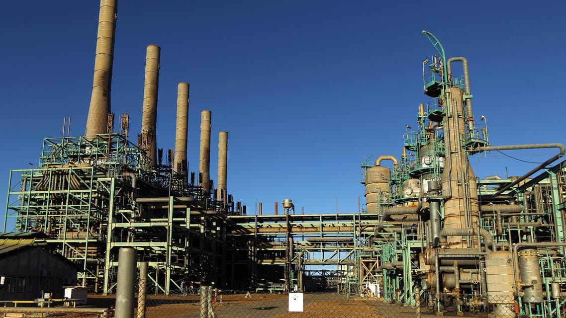 In this file photo taken on January 11, 2017 a general view shows an oil refinery in Libya's northern town of Ras Lanuf on January 11, 2017. Libya is resuming oil exports from its eastern production heartland, its National Oil Corporation said On July 11, 2018 after a showdown between the war-torn country's rival authorities. The internationally recognised NOC was handed back control of four terminals in the oil crescent on Wednesday morning, it said in a statement, adding that. (AFP)