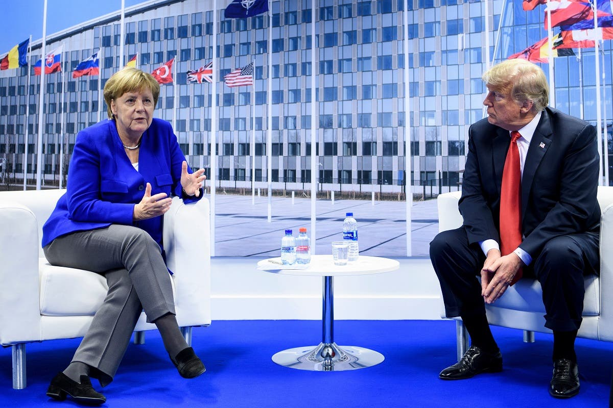 German Chancellor Angela Merkel and US President Donald Trump make a statement to the press after a bilateral meeting on the sidelines of the summit in Brussels. (AFP)