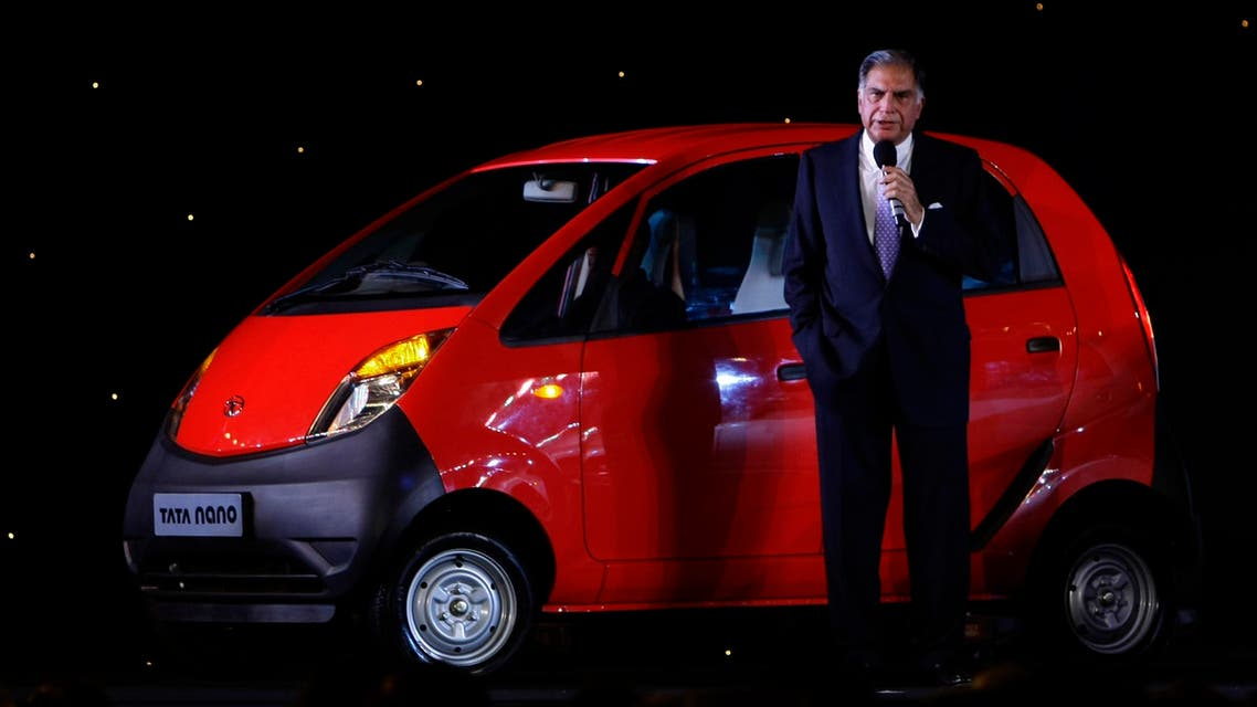 Tata Sons Chairman Ratan Tata speaks as he stands alongside the Nano at its launch in Mumbai on March 23, 2009. (AP)