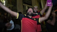 Win or lose, Belgians in diverse Molenbeek show national pride after match