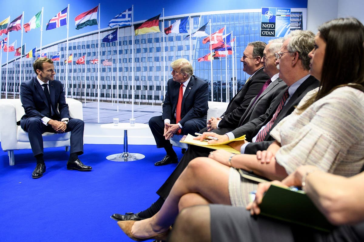 French President Emmanuel Macron (C-L) and US President Donald Trump (C-R), flanked by US Secretary of State Mike Pompeo (R) sit before their bilateral meeting on the sidelines of the NATO Summit in Brussels. (Reuters)