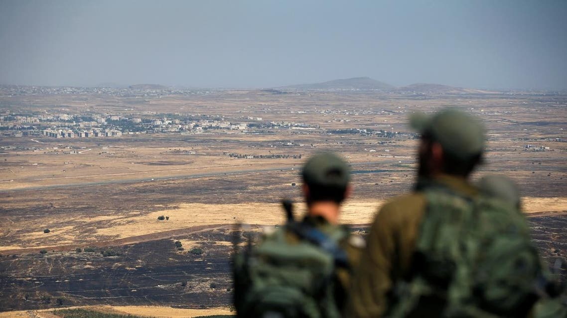 Israel Israeli soldiers look at the Syrian side of the Israel-Syria border on the Israeli-occupied Golan Heights, Israel July 7, 2018. (Reuters)