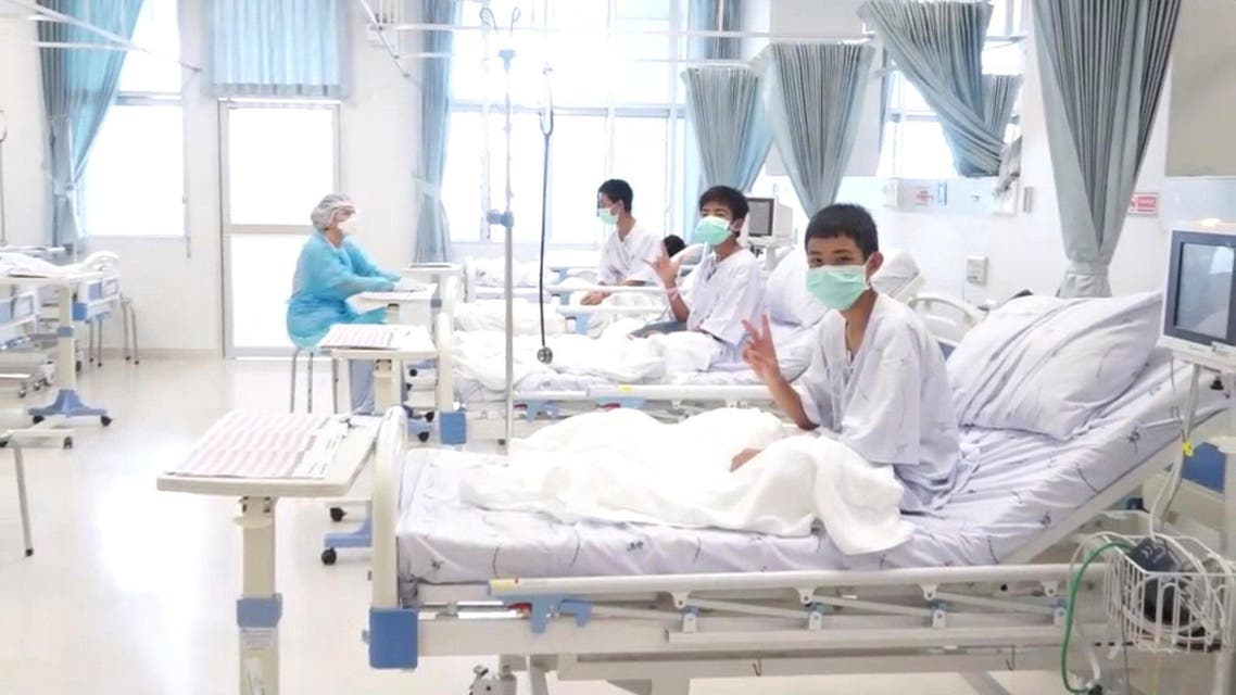 A screen grab shows boys rescued from the Thai cave wearing mask and resting in a hospital in Chiang Rai. (Government Public Relations Department)