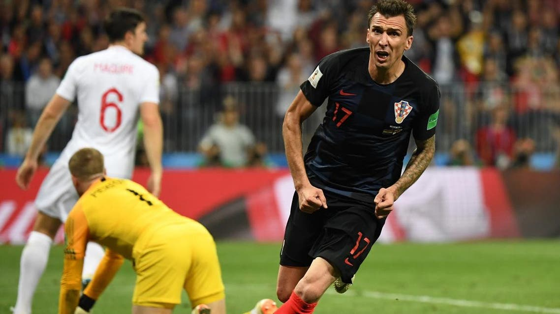 Croatia's forward Mario Mandzukic celebrates after scoring his team's second goal during the Russia 2018 World Cup semi-final football match between Croatia and England at the Luzhniki Stadium in Moscow on July 11, 2018. (AFP)