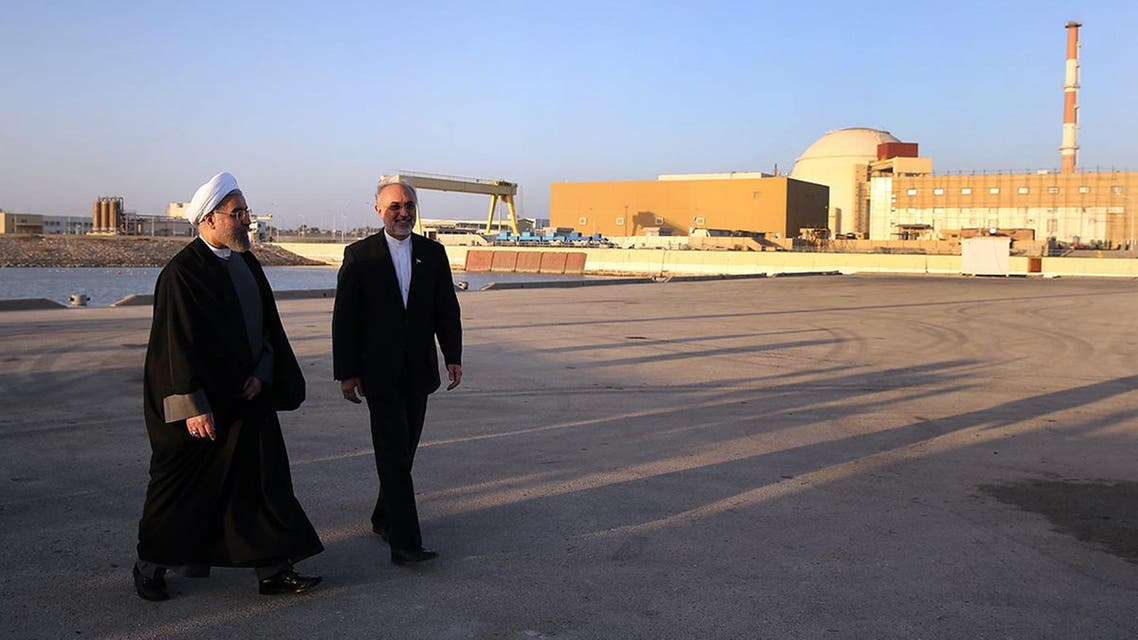 Iranian President Hassan Rouhani with Iran's Atomic Energy Organisation chief Ali Akbar Salehi at the Bushehr nuclear power plant on January 13, 2015. (AFP)