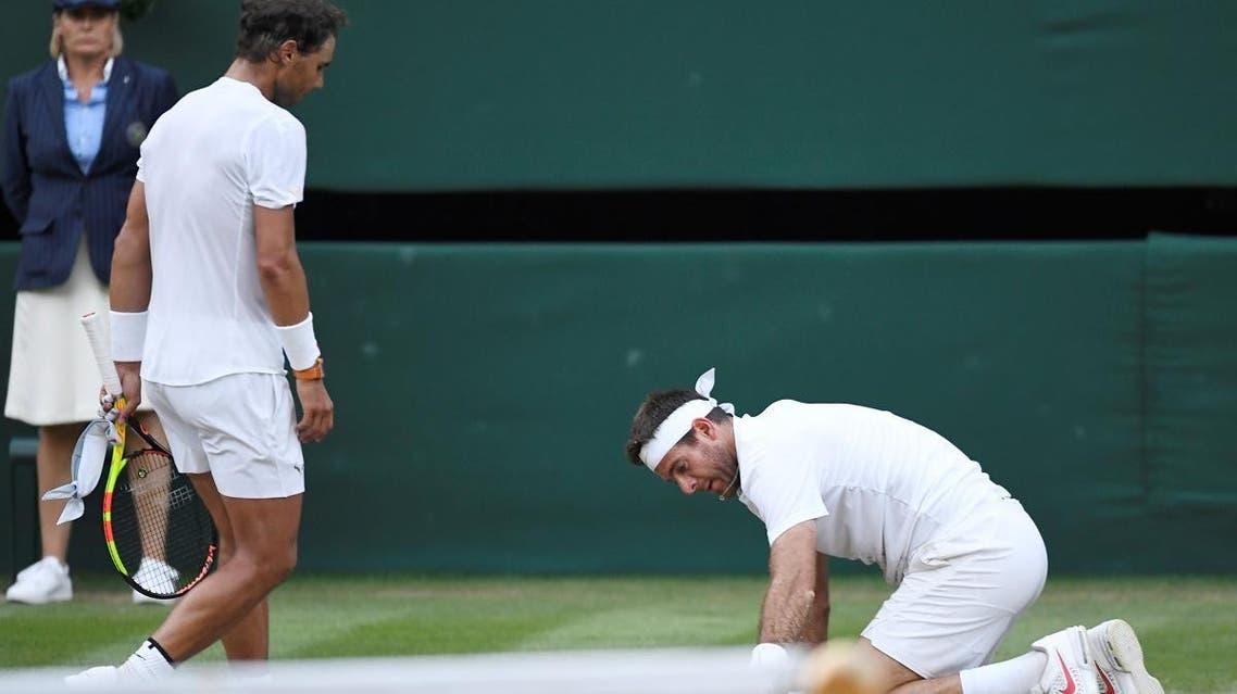 Spain's Rafael Nadal walks towards Argentina's Juan Martin Del Potro after winning his quarter final match at wimdledon. (Reuters)