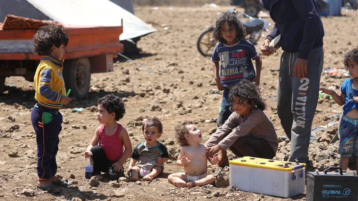 Internally displaced children from Deraa sit together near the Israeli-occupied Golan Heights in Quneitra, Syria July 11, 2018. REUTERS/Alaa Al-Faqir
