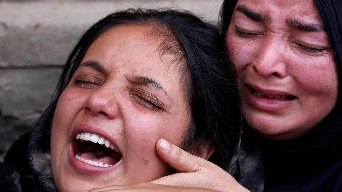 Relatives of a civilian who died during clashes between protesters and Indian security forces, mourn during in South Kashmir on July 7, 2018. (Reuters)