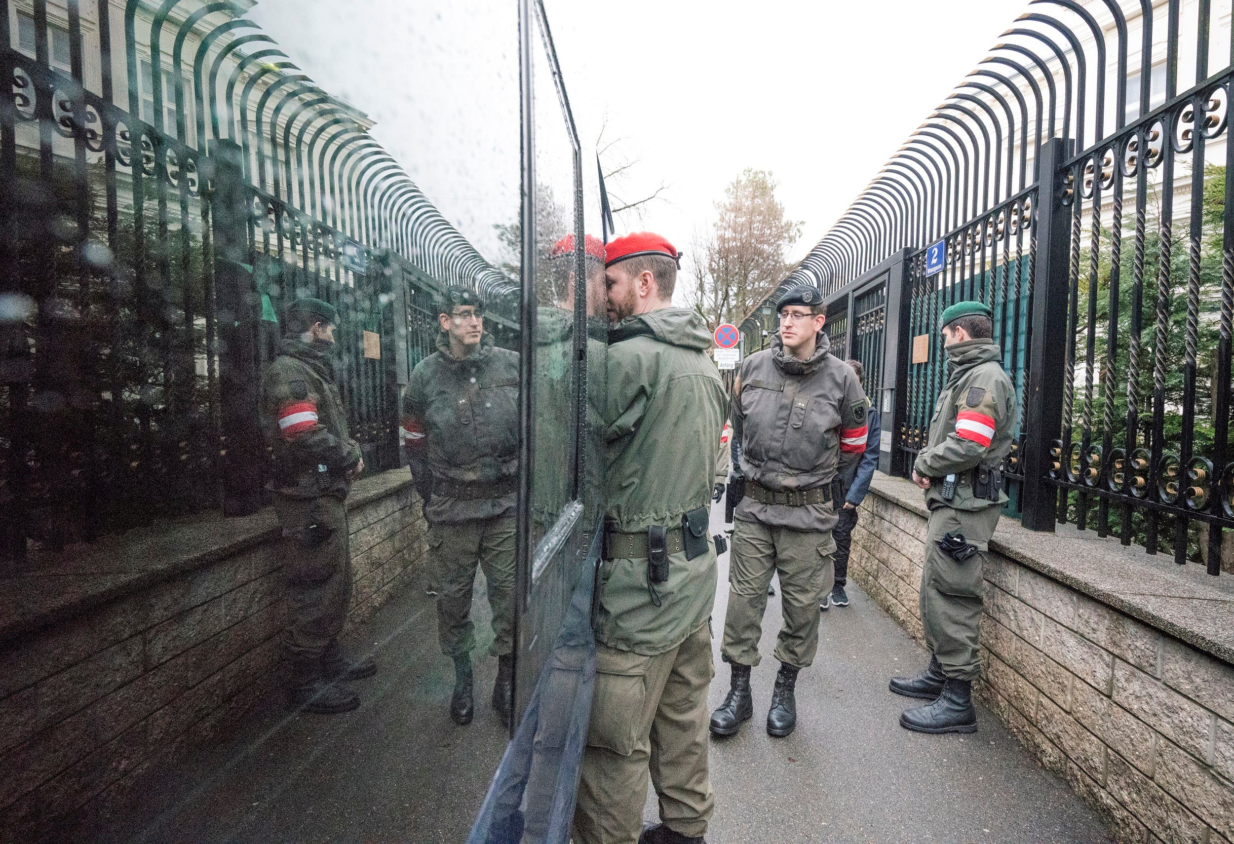 Austrian soldiers stand guard outside the Iran ambassador's residence in Vienna, on March 12, 2018. (AFP)