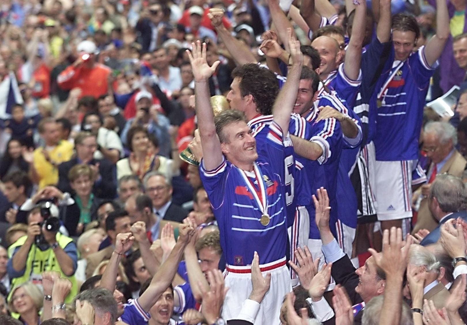 Deschamps and teammates jubilate in the stands after France won the World Cup final at the Stade de France on July 12, 1998. (AFP)