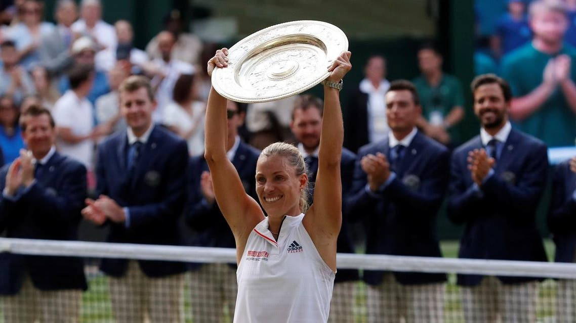 Kerber celebrates winning the women's singles final with the trophy. (Reuters)