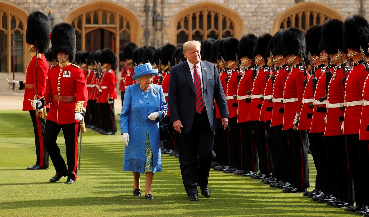 US President Donald Trump and Britain's Queen Elizabeth inspect the Coldstream Guards during a visit to Windsor Castle in Windsor, Britain, July 13, 2018. (Reuters)