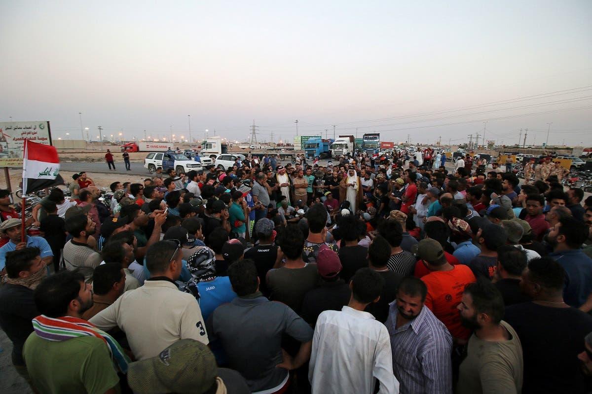 Protesters block the road to Iraq's Umm Qasr port, south of Basra, Iraq. (Reuters)