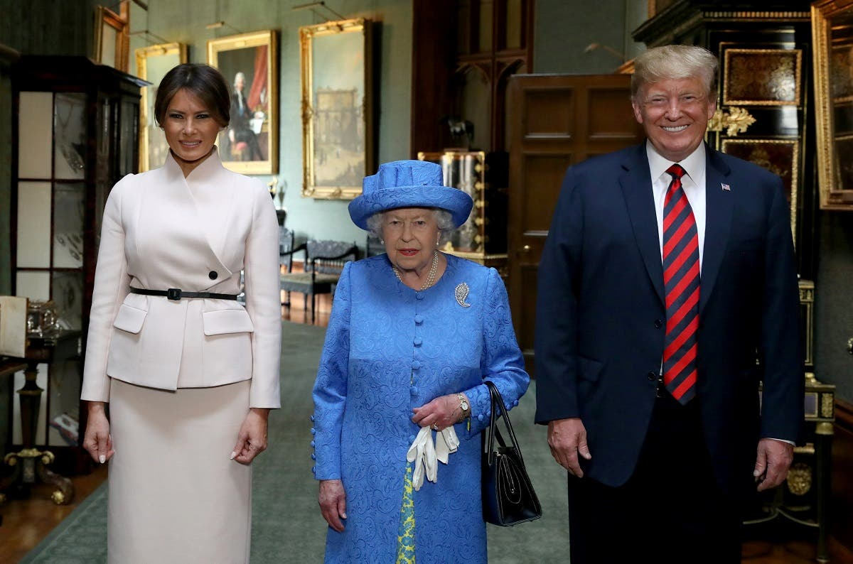 Queen Elizabeth with US President Donald Trump and his wife, Melania in the Grand Corridor during their visit to Windsor Castle. (Reuters)