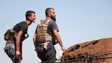 Syrian rebels surrender heavy weapons in Daraa city