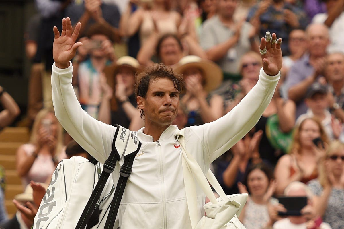 Rafael Nadal leaves the court after losing to Novak Djokovic during the continuation of their Wimbledon men's singles semi-final match. (AFP)
