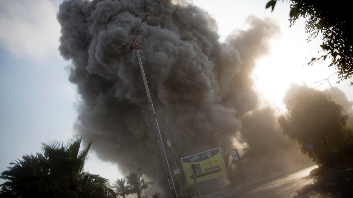 Smoke raises in the background following an Israeli airstrike hits a governmental building in Gaza City , Saturday, July 14, 2018. (AP)