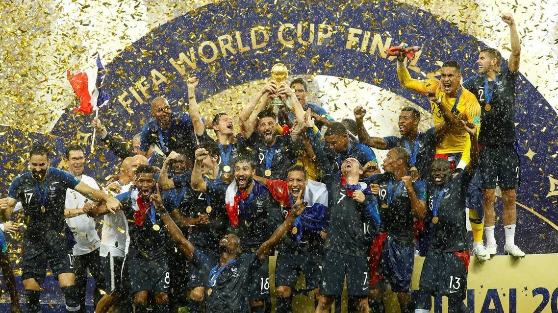 France players celebrate with the trophy after winning the World Cup. (Reuters)