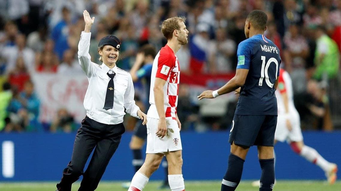A pitch invader, Croatia's Ivan Strinic and France's Kylian Mbappe. (Reuters)