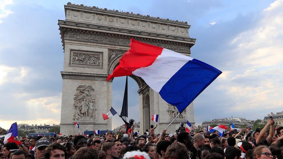 France fans react on the Champs-Elysees avenue near the Arc de Triomphe after they defeated Croatia. (Reuters)