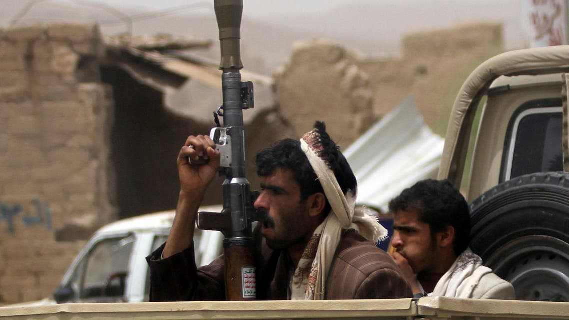 Houthi militants ride in an open vehicle while carrying weapons to secure a road in the northwestern province of Saada, June 4, 2013. (Reuters)