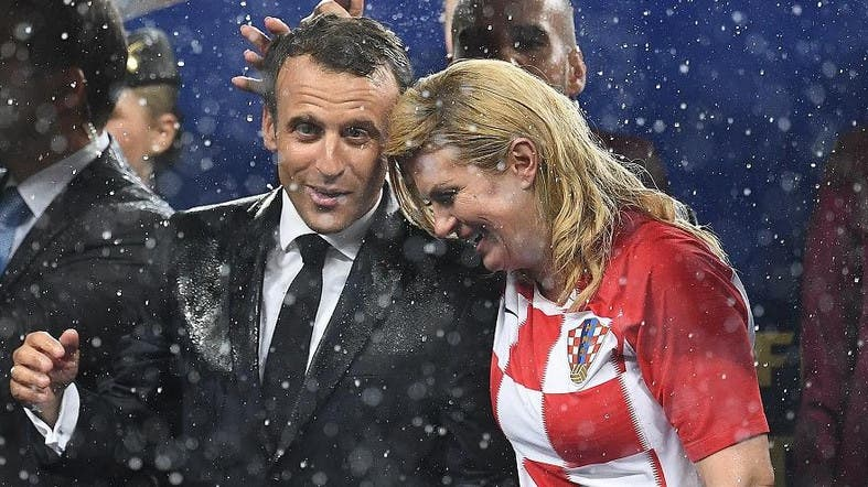 Soaked but smiling, Croatian president wins admirers at