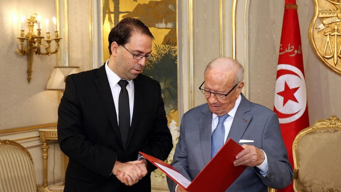 Tunisia's Prime Minister Youssef Chahed presenting his new cabinet to Tunisian President Beji Caid Essebsi at the Carthage Palace. (File photo: AFP)