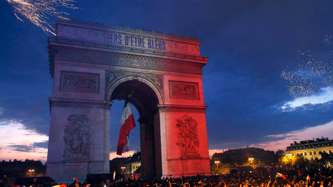 The Arc de Triomphe is illuminated with the colors of the French national flag and by fireworks set off by French soccer fans celebrating France's World Cup victory over Croatia, in Paris, France, Sunday, July 15, 2018. (AP)