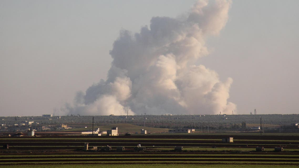 A picture taken from a rebel-held area shows smoke billowing in the Al-Nayrab area, near Idlib, following reported Syrian government air strikes on January 22, 2017.