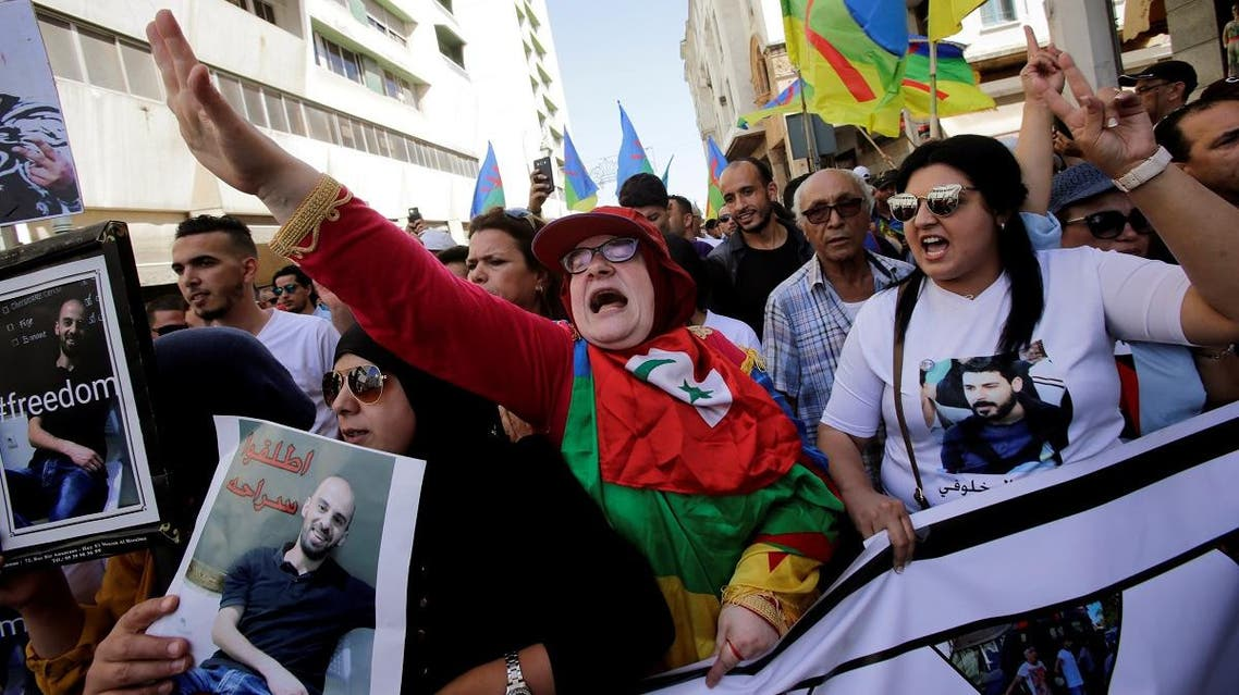 """A woman shouts slogans during a demonstration against the Moroccan court after the jailing of Moroccan activist and leader of """"Hirak"""", Nasser Zefzafi, and a number of other activists, in the Moroccan capital of Rabat. (Reuters)"""