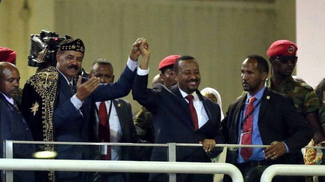 Eritrea's President Isaias Afwerki and Ethiopian Prime Minister Abiy Ahmed hold hands during a concert at the Millennium Hall in Addis Ababa, Ethiopia July 15, 2018. REUTERS