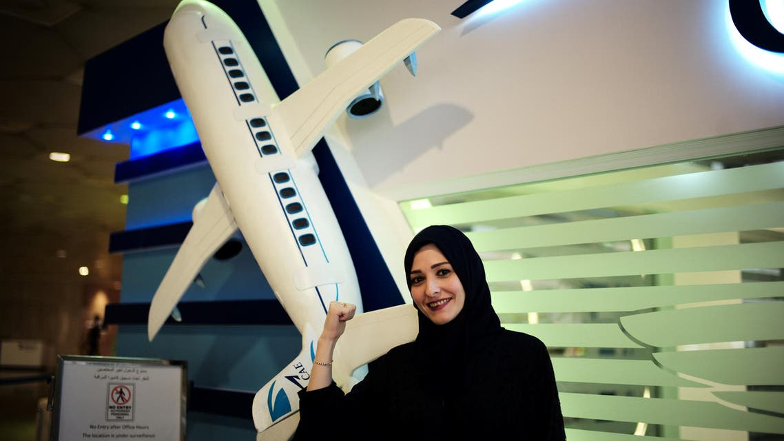 Majdooleen Hammad, one of the female staff, speaks to a student at the registration centre, CAE Oxford ATC, where Saudi women can pursue their carrier as a commercial pilots. (Reuters)1