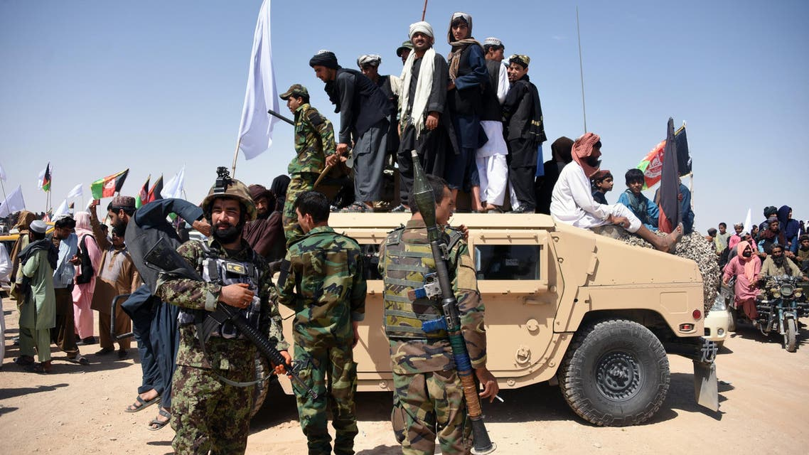 Afghan Taliban militants and residents celebrate ceasefire in Kandahar on June 17, 2018. (AFP)