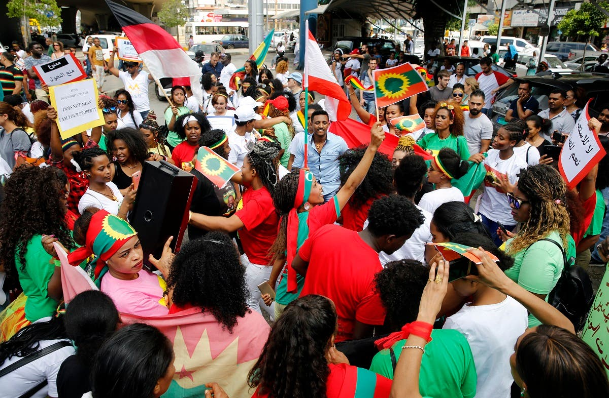 Migrant domestic workers dance during a rally to mark International Domestic Workers Day, in Beirut, Lebanon, Sunday, June 24, 2018. The protesters are demanding that the Kafala, or sponsorship law, be abolished, and called for better treatment. The Kafala system ties workers to their employers whose consent is needed for renewal of residency permits, changing jobs or for workers to return home. (File photo: AP)