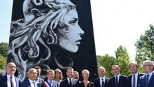 Macron unveils new face of France's 'Marianne'