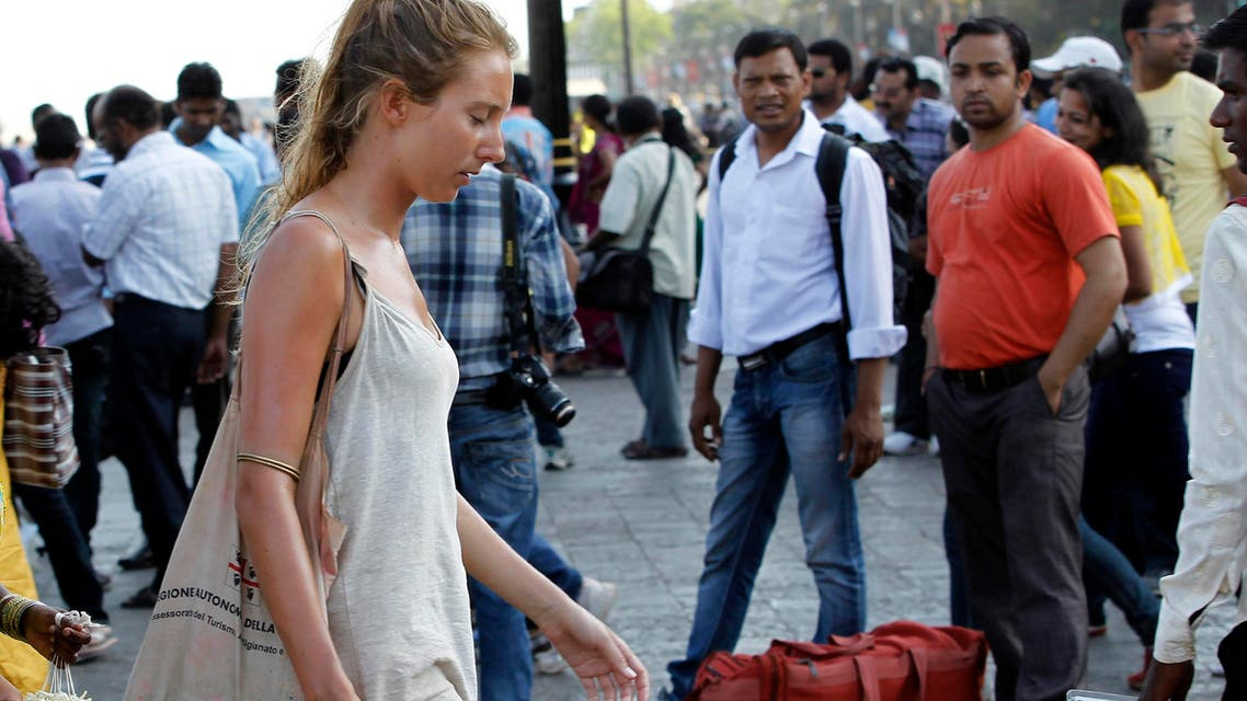 A German tourist walks near the landmark Gateway of India in Mumbai. (File photo: AP)