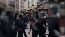 WATCH: President Macron's bodyguard beating protester in Paris