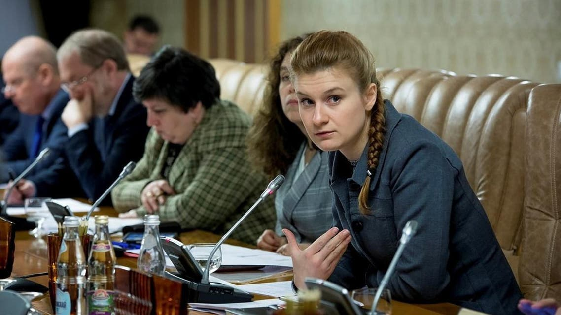 Public figure Maria Butina (R) attends a meeting of a group of experts, affiliated to the government of Russia, in this undated handout photo. (Reuters)