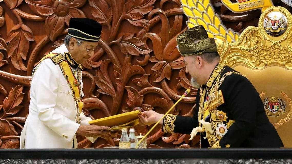 Malaysian Prime Minister Mahatir Mohamad, left, passes the opening speech to King Sultan Muhammad V during the opening of the 14th parliament session at the Parliament house in Kuala Lumpur, Malaysia, Tuesday, July 17, 2018.(AP)