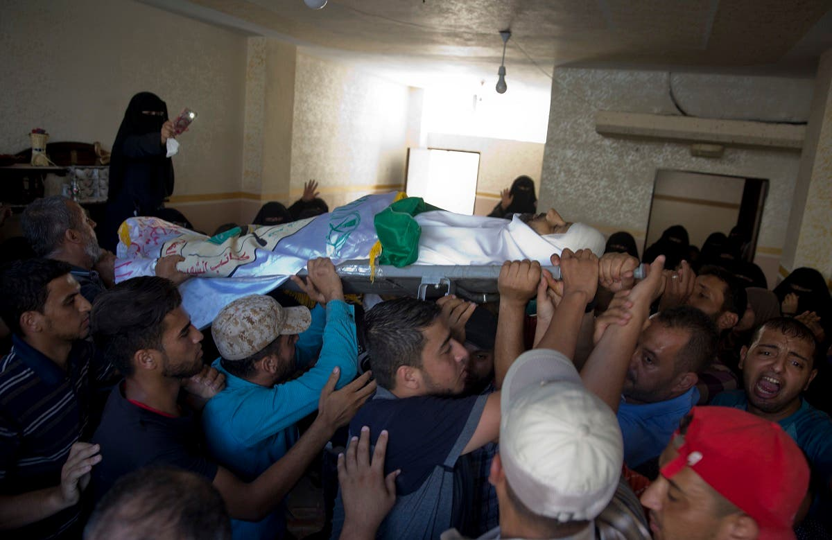 Palestinian mourners carry the body of Hamas militant Abdul Kareem Radwan, 22, out of the family home during his funeral in Town of Rafah, Southern Gaza Strip, Friday, July 20, 2018. (AP)