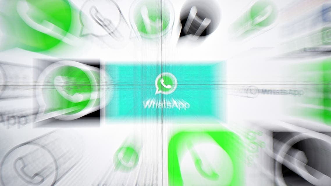 This photo illustration taken on March 22,2018 shows Whatsapp logos on a screen in Kuala Lumpur.