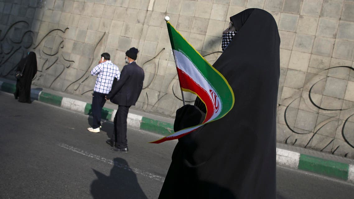 A woman holds an Iranian flag while attending a rally marking the 39th anniversary of Iran's 1979 Islamic Revolution, in Tehran on Feb. 11, 2018. (AP)