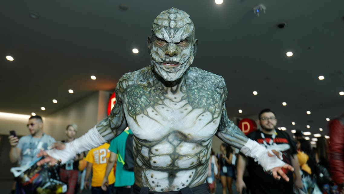 Eli Garcia dressed as the character Killer Croc from the Batman series poses during opening day of Comic-Con in San Diego on July 19, 2018. (Reuters)
