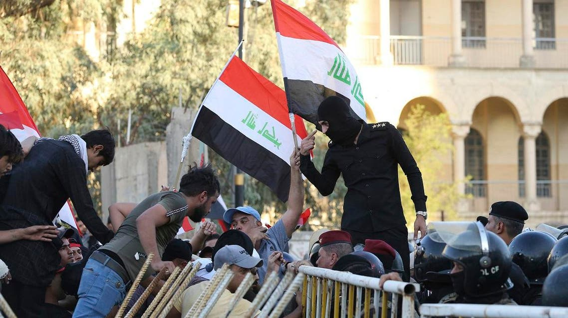 Iraqi riot police block protesters from gaining access to the heavily guarded Green Zone during protests demanding services and jobs in central Baghdad, on Friday, July 20, 2018. (AP)