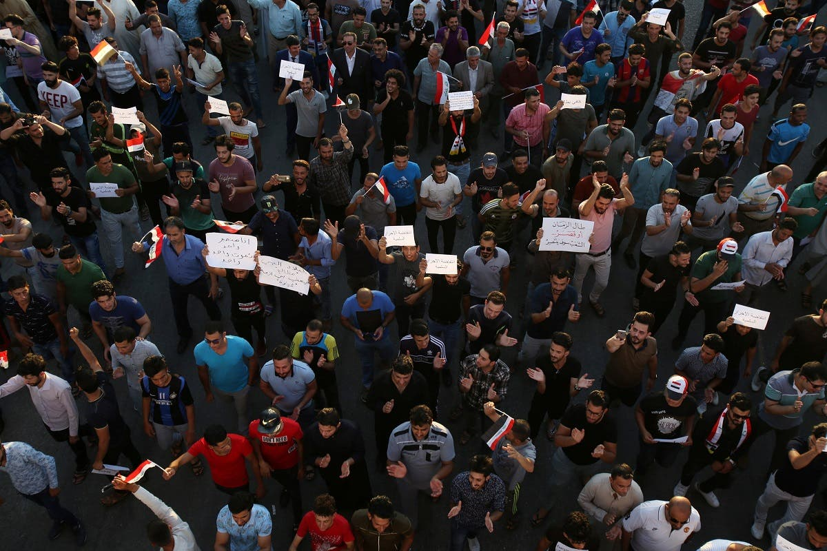 People gather during a protest in Karbala. (Reuters)