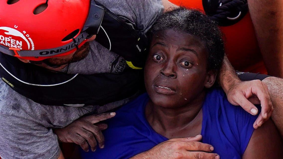 رئيسية Josepha, the woman who was rescued on July 17, 2018, rests on board of NGO Proactiva Open Arms rescue boat in central Mediterranean Sea, July 20, 2018. REUTERS/Juan Medina