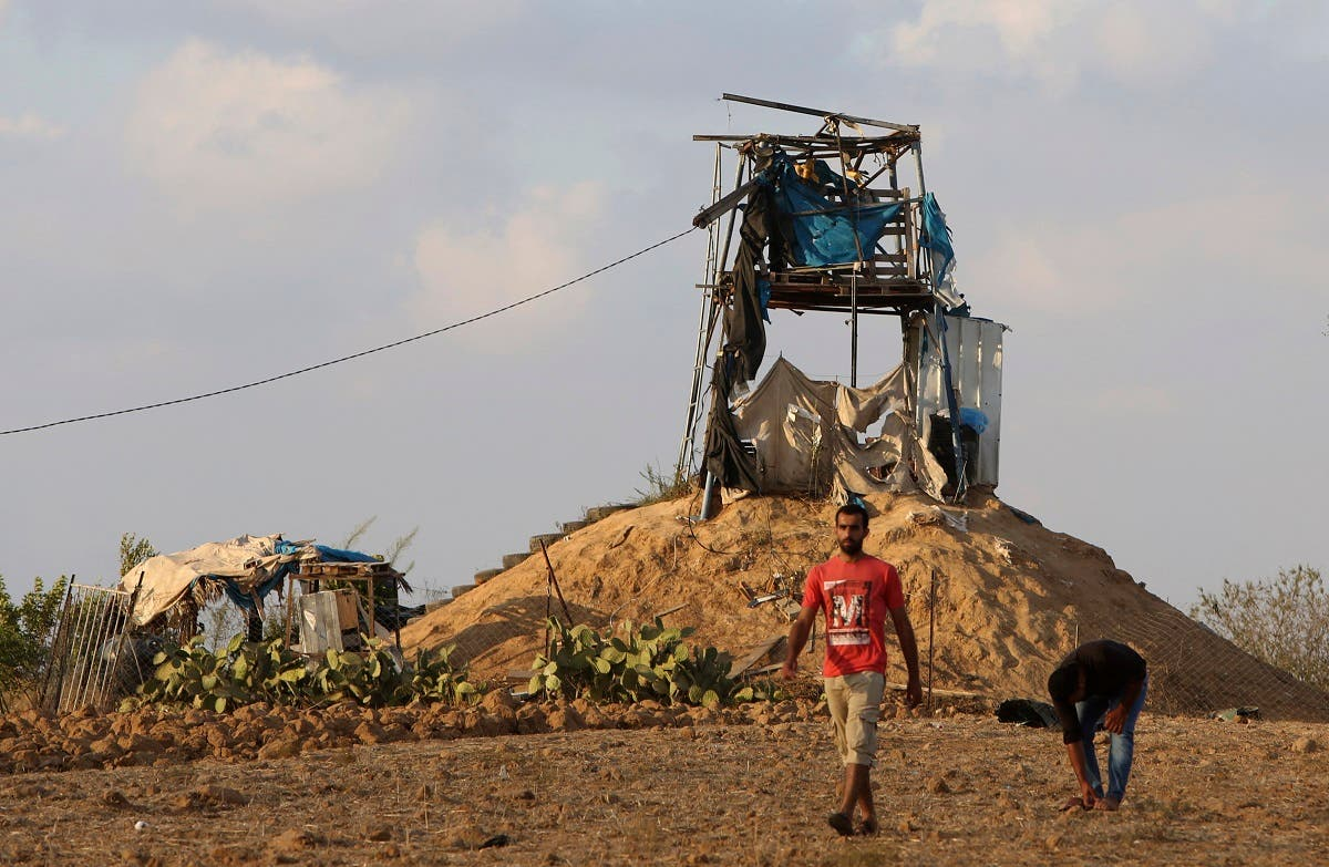 Palestinians inspect a military observation post that was hit by an Israeli tank shell east of Khan Younis, southern Gaza Strip, Friday, July 20, 2018. (AP)