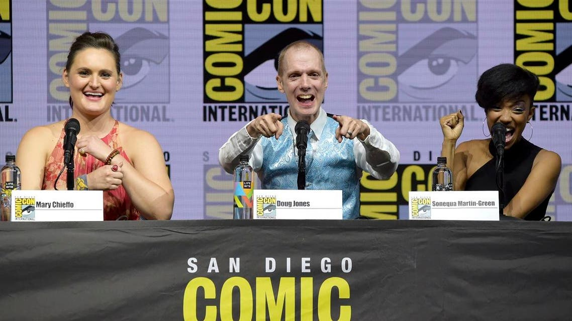 """Mary Chieffo, from left, Doug Jones and Sonequa Martin-Green react to the crowd at the """"Star Trek: Discovery"""" panel on day two of Comic-Con International on Friday, July 20, 2018, in San Diego. (AP)"""