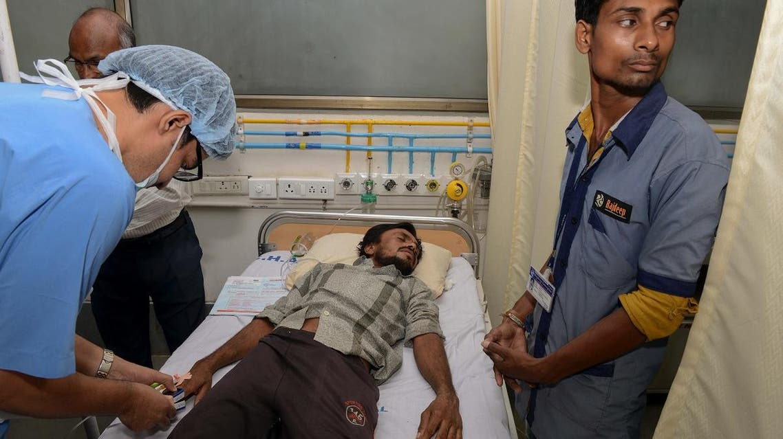 """One of the four villagers from the lowest Dalit caste attacked by Hindu """"cow vigilantes"""" is treated in a hospital in Ahmedabad on July 27, 2016. (AFP)"""