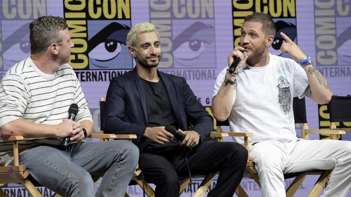 "Ruben Fleischer, from left, Riz Ahmed and Tom Hardy attend the ""Venom"" panel on day two of Comic-Con International on Friday, July 20, 2018, in San Diego. (AP)"